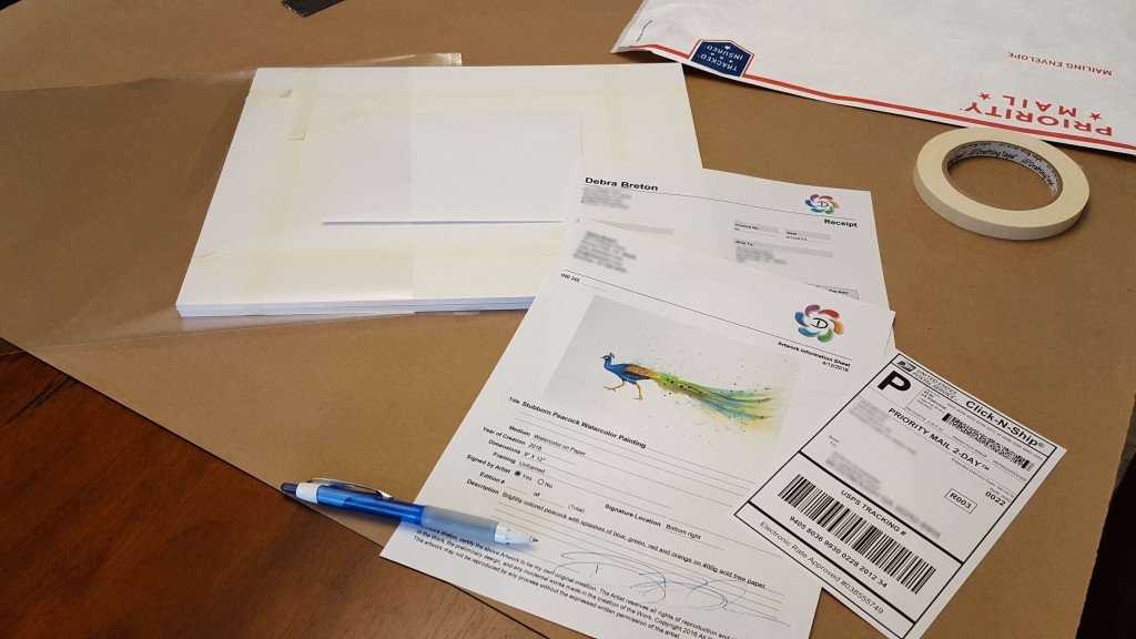 package with artwork and certificate of authenticity ready to be mailed